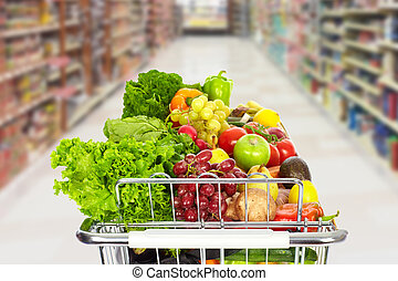 Grocery shopping cart with vegetables.