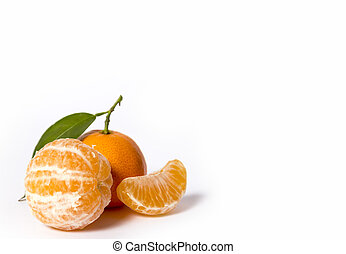 Ripe mandarin with leaves close-up on a white background...