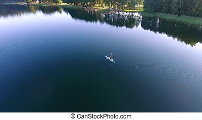 people travel in tourist boat over lake - aerial view of...