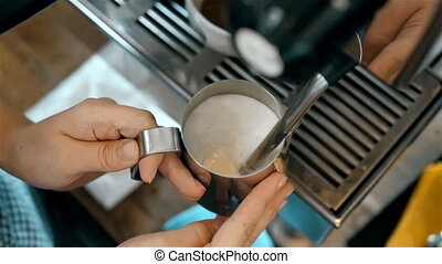 Barista Steaming Milk For Hot Cappuccino Coffee With...