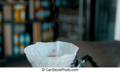 Ground Coffee Is Poured Into a Bowl. - Ground Coffee Is...