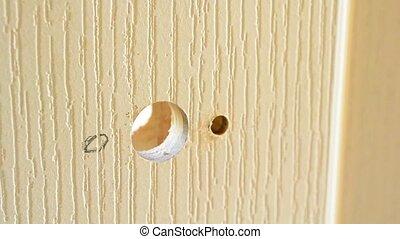 Drilling hole in a door to install door lock or handle -...