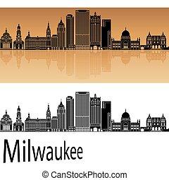 Milwaukee skyline in orange background in editable vector...