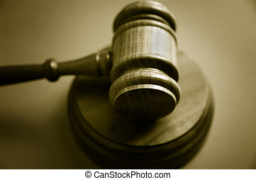 wooden judges gavel on blue background