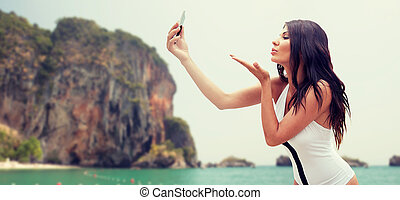 young woman taking selfie with smartphone - summer, travel,...