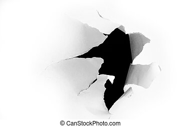 Side view of a torn jagged hole in paper