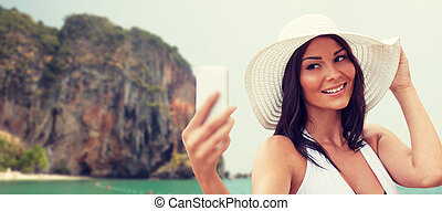 young woman taking selfie with smartphone - travel, summer,...