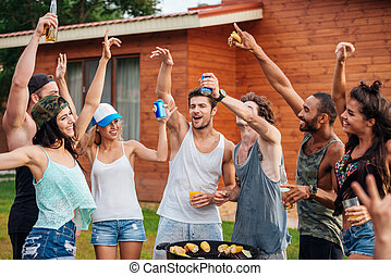 Cheerful young friends having fun outdoors - Group of...