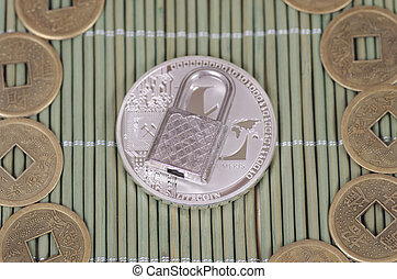 Litecoin - Silver-plated Litecoin and padlock on a wooden...