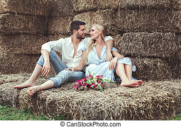 Loving couple retired to the straw. - Loving couple retired...