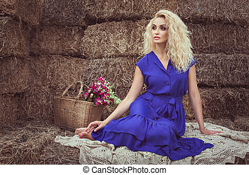 Blonde woman in the hayloft. - Beautiful blonde woman in the...