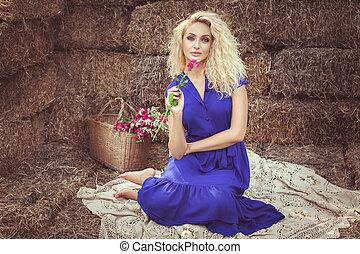 Beautiful woman in the hayloft. - Beautiful woman sitting in...