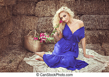 Woman on hayloft sitting and smiling. - Beautiful woman on...