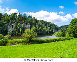 Beautiful lake and sandstone towers in Bohemian Paradise, or...