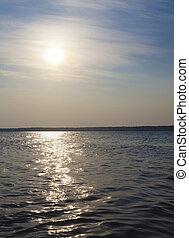 Rising sun - Sun rising above a lake in noirthern...