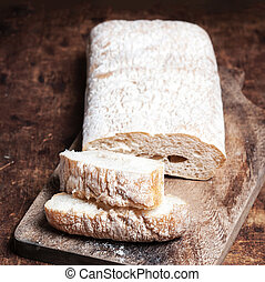 Fresh bread on wooden background. White baked bread on a wooden table with copy space