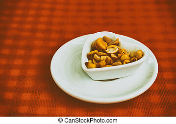 Heart Shaped Bowl With Dried Hard Fruits And Peanuts