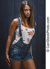Sexy young woman in overalls - sexy twenty something girl in...