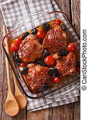 Roasted pieces of chicken with mustard, tomatoes and...