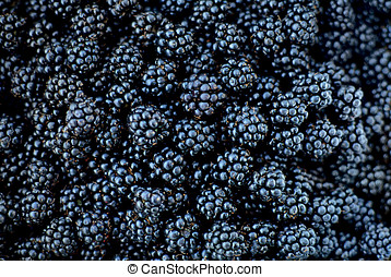Blackberries juicy wild fruit raw food on background