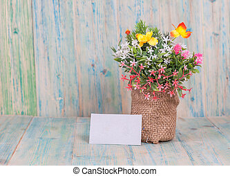 Bouquet of flowers with blank paper tag