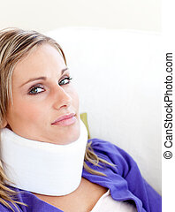 Young woman with a neck brace looking in the camera against...