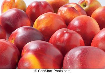Fresh nectarines on white background juicy fruit
