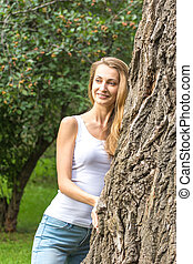 Close up Thoughtful Young Nature-Lover Woman Hugging a Huge...
