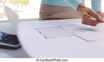woman with architectural blueprint and pencil - business,...