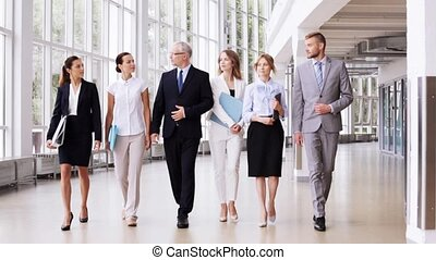 business people walking along office building 2 - people,...