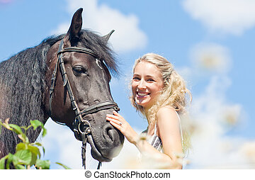 Beautiful woman and horse - Happy beautiful woman and black...