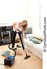 Beautiful woman use vacuum cleaner