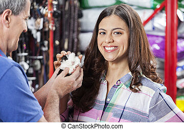 Female Customer Buying Guinea Pig From Salesman - Portrait...