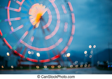 Abstract Blur Image Of Illuminated Ferris Wheel In Amusement...