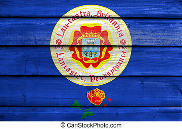 Flag of Lancaster, Pennsylvania, USA, painted on old wood plank background