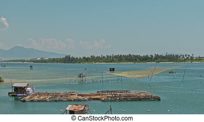 Bamboo Rafts Fishing Nets in Sea Bay in Vietnam - Vietnamese...