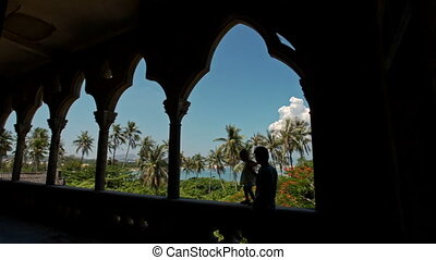 Man Little Girl Silhouettes in Gallery Arch of Gothic...