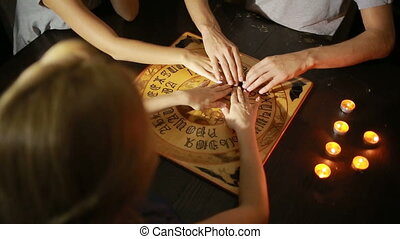 group of people at a spiritualistic people call spirits -...