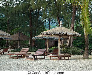 Lounge chairs and sunshade umbrella on the beach - Lounge...