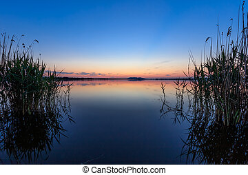 sunet over lake - after sunset in the Danube Delta , Romania