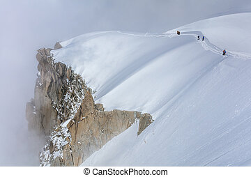 Climbers on the Mont Blanc massif. View from Aiguille du...