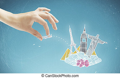 Travel concept - Female hand holding abstract airplane...