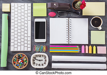 Creative office desktop - Top view of wooden office desktop...