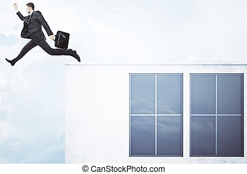 Man jumping off concrete building - Businessman with...