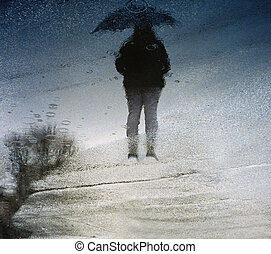 Shadow\'s Walk - The shadow of a woman and an umbrella with...