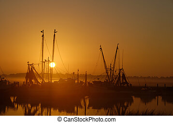 Shrimp Boats at Sunrise - Shrimps boats in the mist at...
