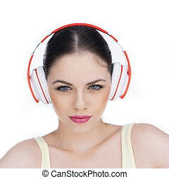 Closeup of a girl listening to music over white background