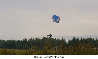 Paraglider flying at low altitude
