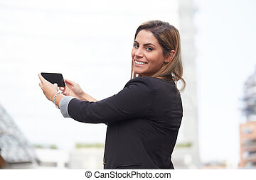 young businesswoman taking a selfie