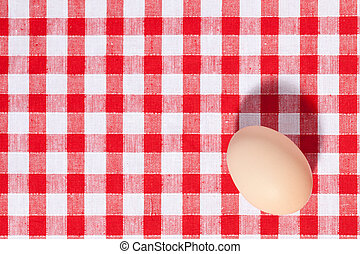 egg on picnic tablecloth